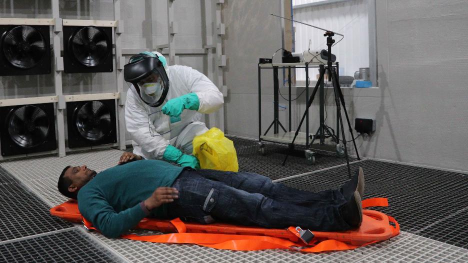 Scientist testing equipment on patient
