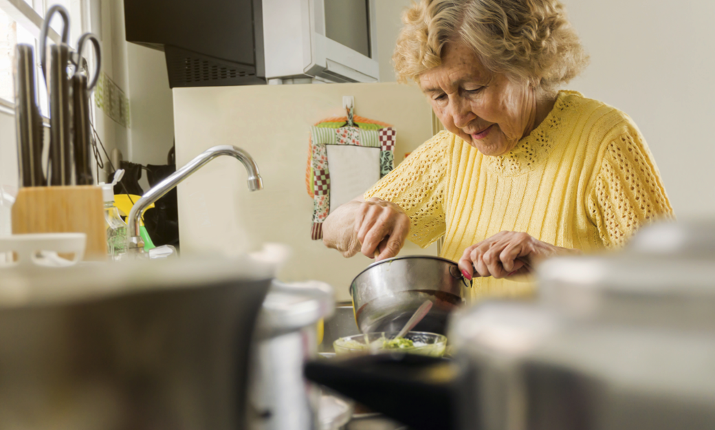 Older adult making a meal in her kitchen