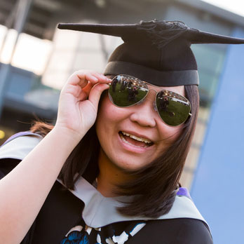 Graduate wearing sunglasses