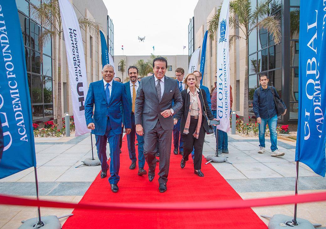 Group walking down red carpet at GAF