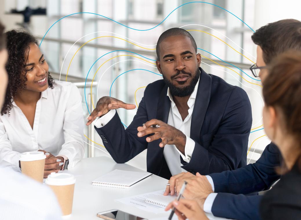 Male staff member talking in meeting