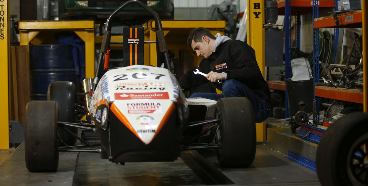 Student working on F1 car