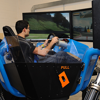 A student practises in our automotive engineering cruden simulator