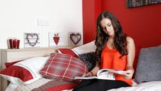 A student reading in her room