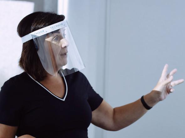 Lecturer wearing visor