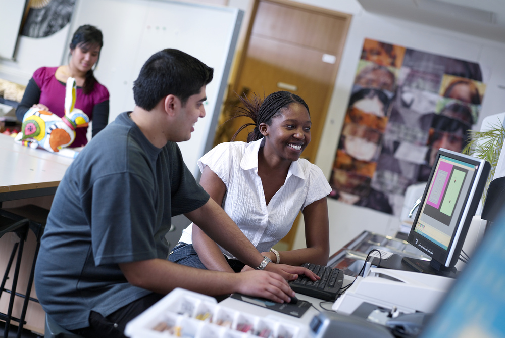 Black female student and male student working at computer