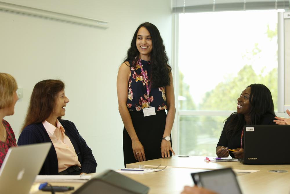 Women standing up in meeting
