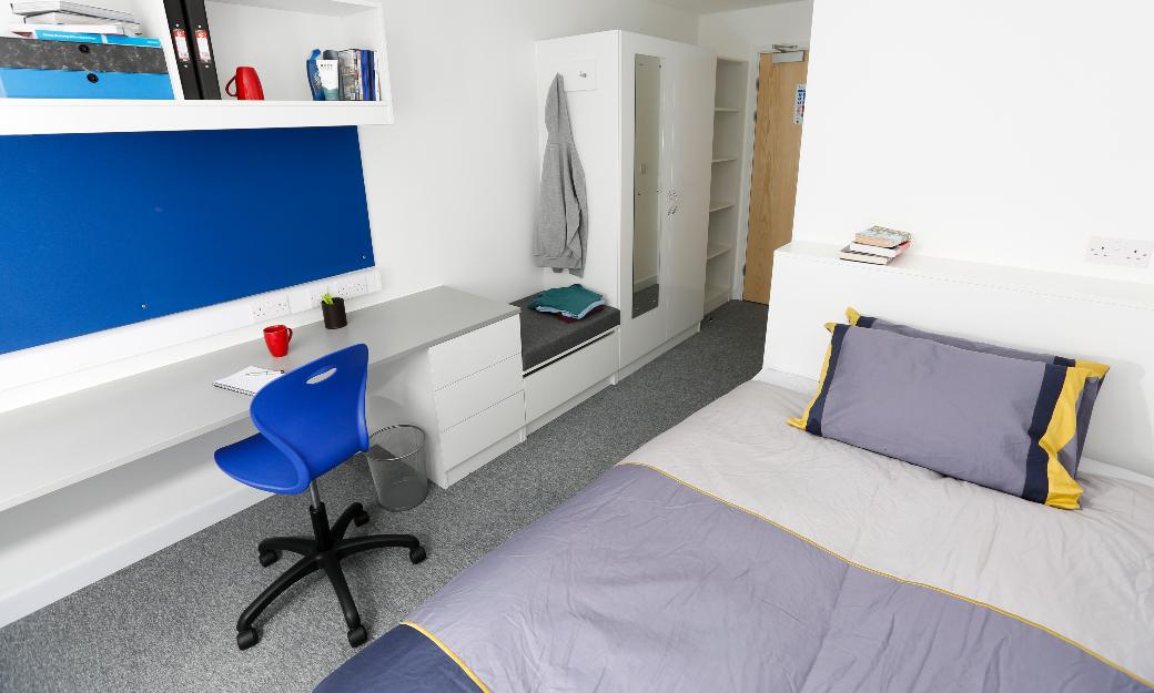 Bedroom with blue duvet