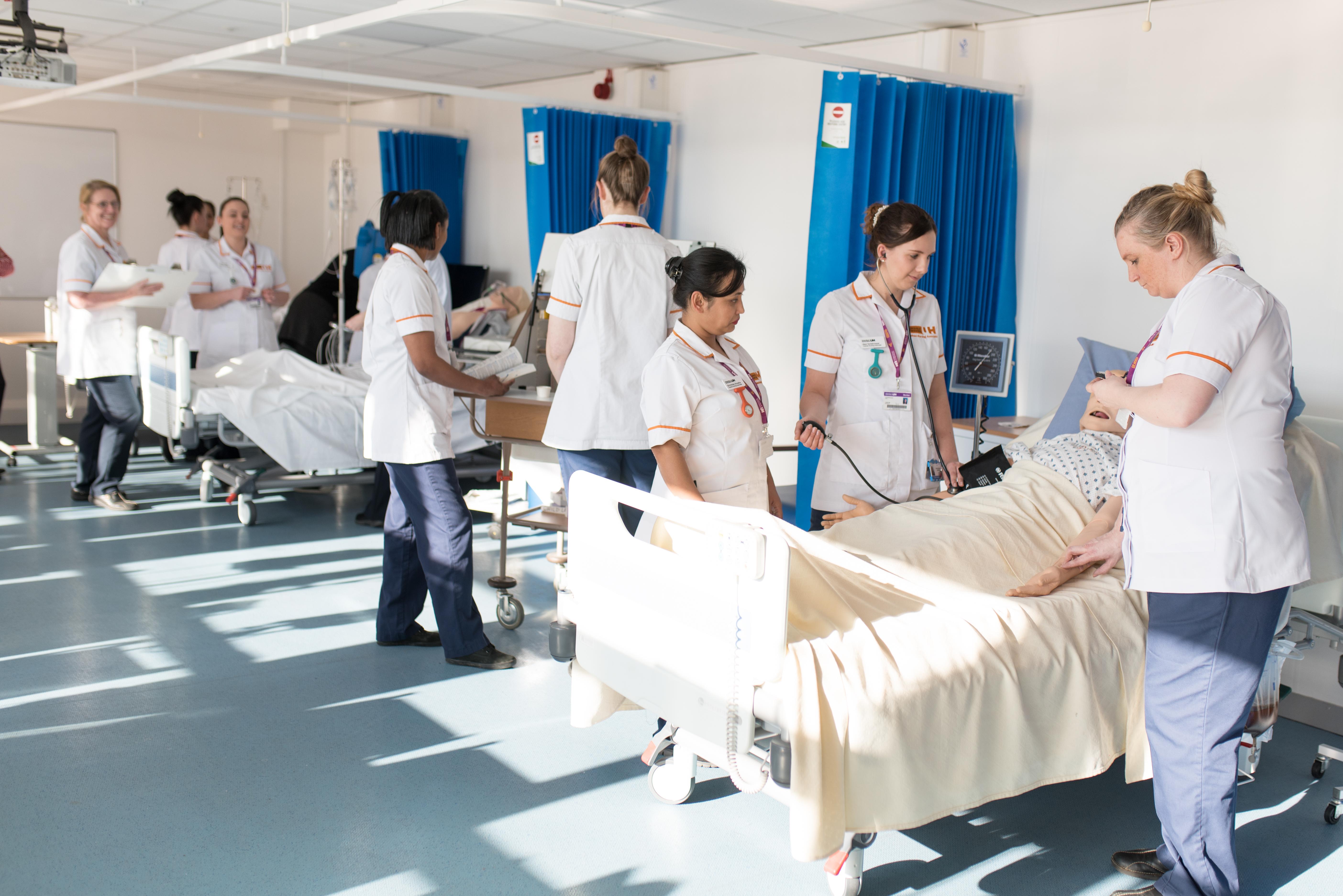 Nursing associates in training in a ward
