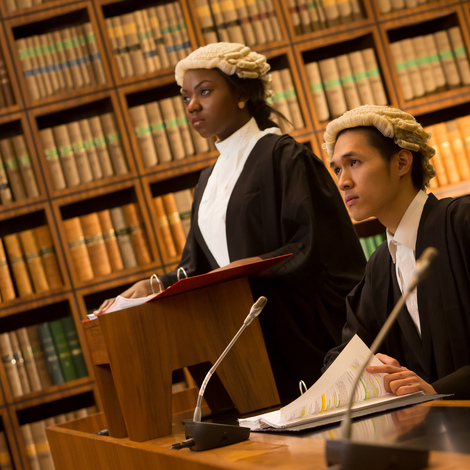 Female judge and male assistant