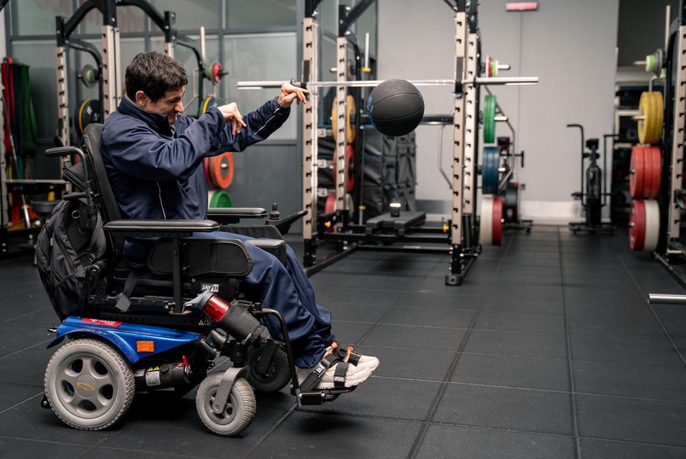 Man in wheelchair throwing ball