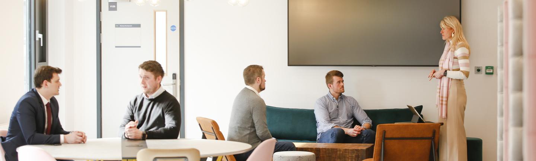 Incubator members working together in Enterprise Hub