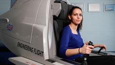 A female student using the flight simulator