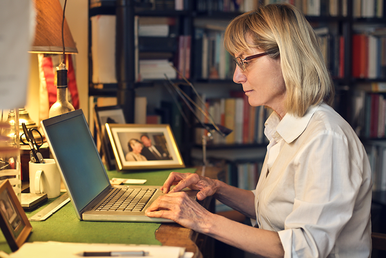 Woman working in home library