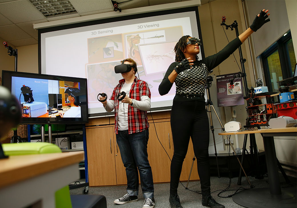 Female and male student using VR technology