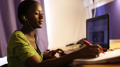 Black female student studying at desk