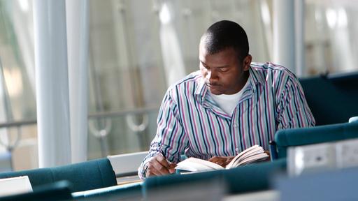 Mature student reading book