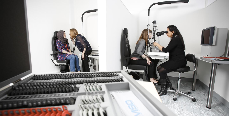 Optometry patients having their eyes tested