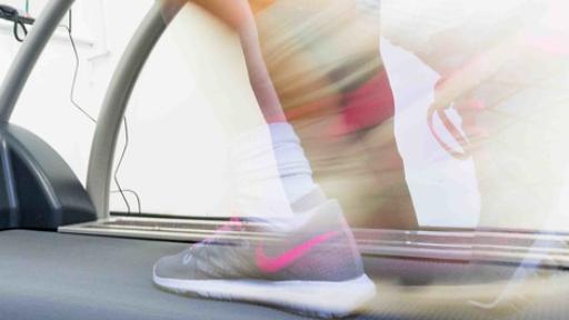 Trainers on treadmill