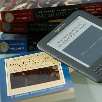 A pile of books and a kindle