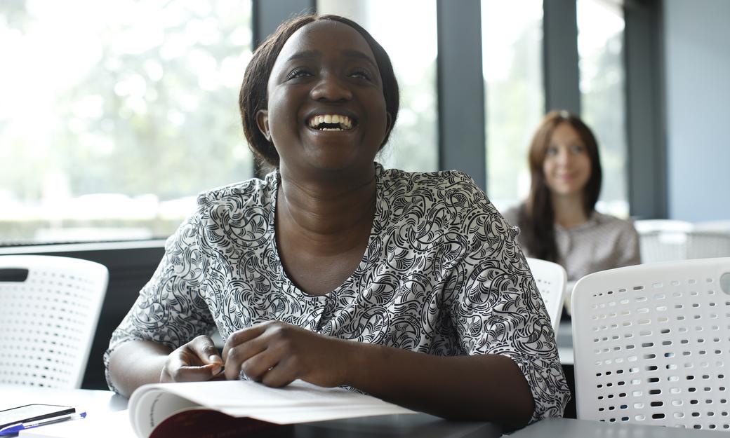 Student in seminar smiling