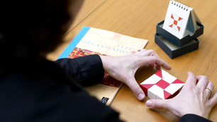 A pair of hands holding a puzzle